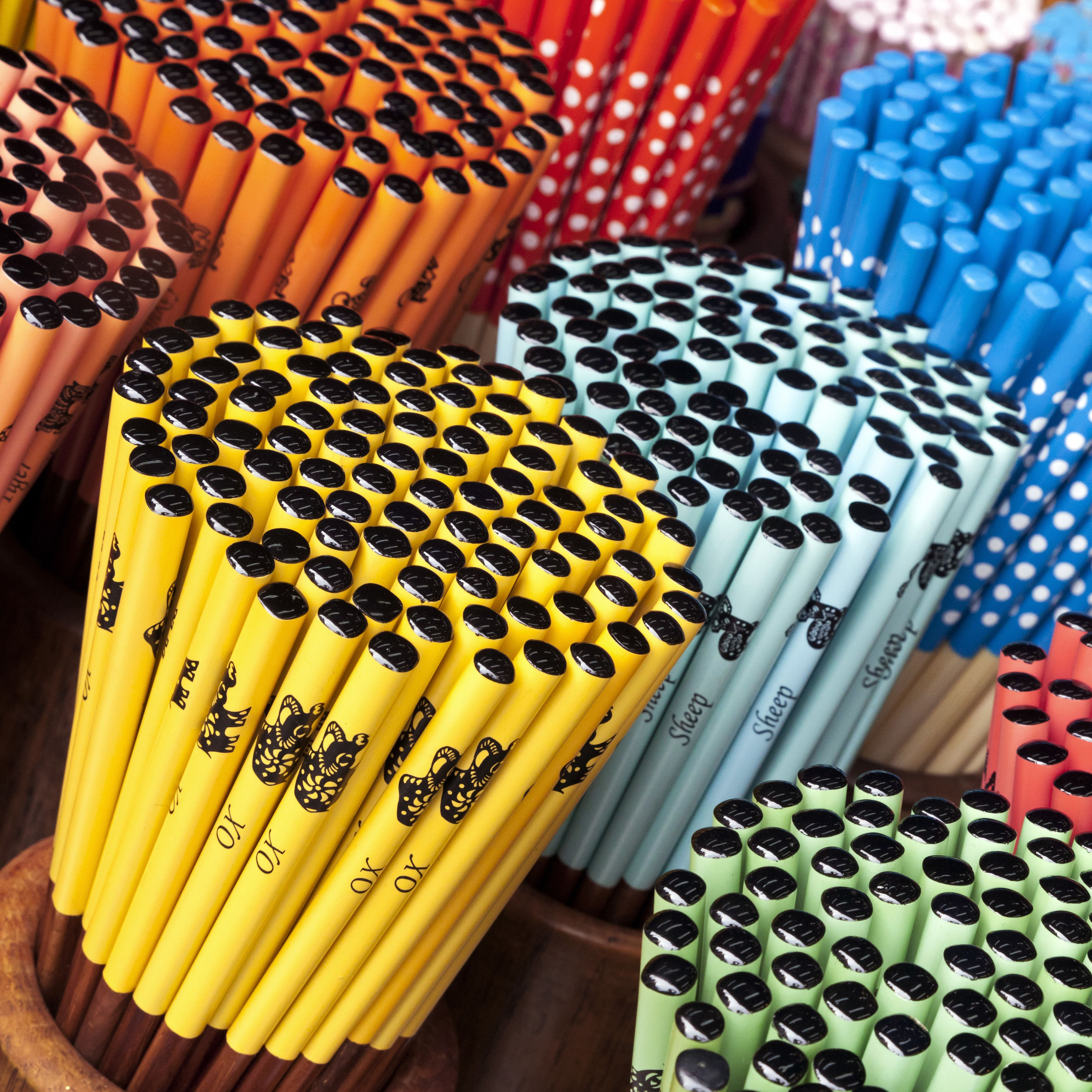 Colourful decorative Chopsticks for sale as souvenirs to tourists in Chinatown market, Temple Street, Singapore