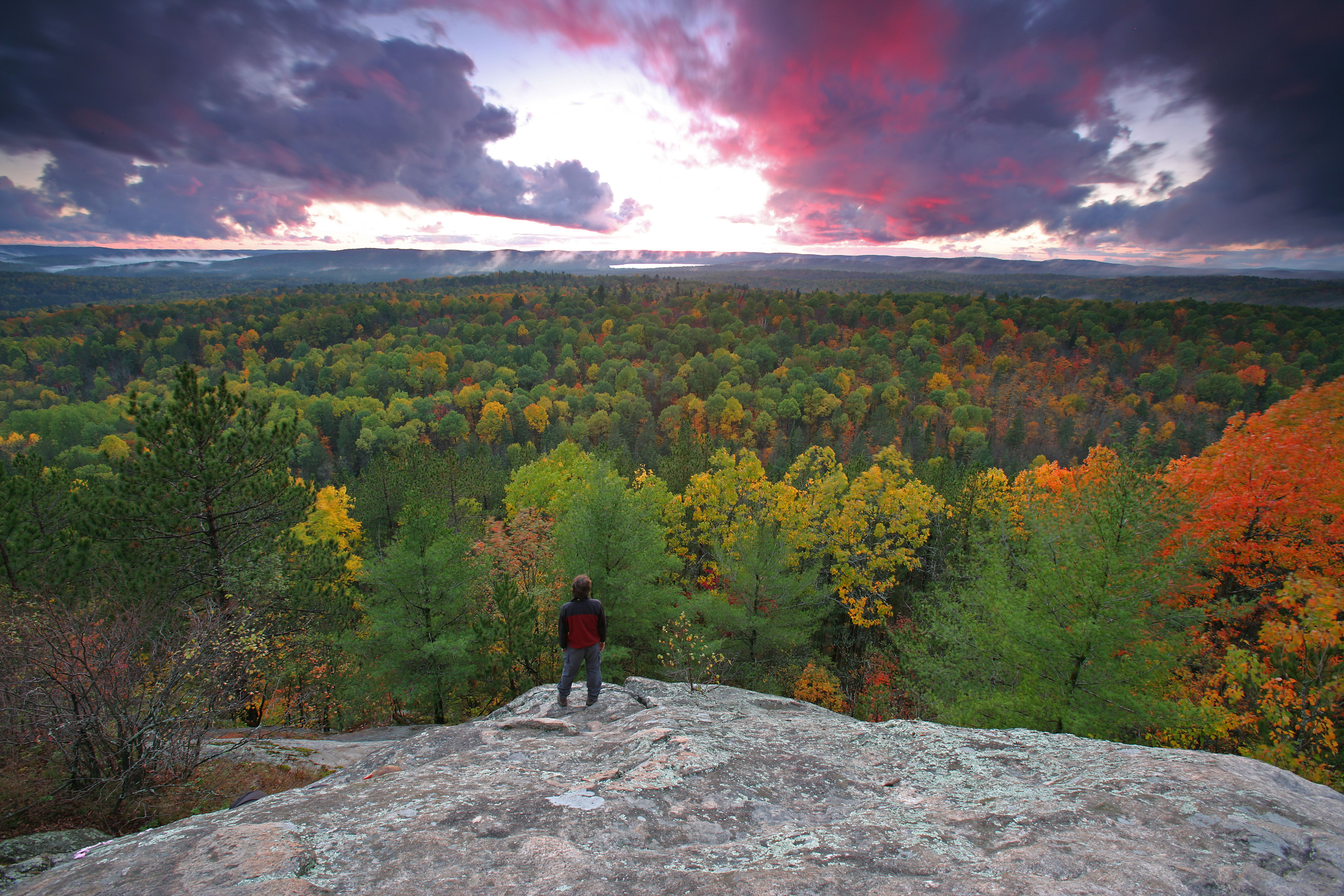 Hiker on Lookout Trail at Sunset in Autumn, Algonquin Park, Ontario