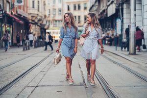 Two women strolling on street