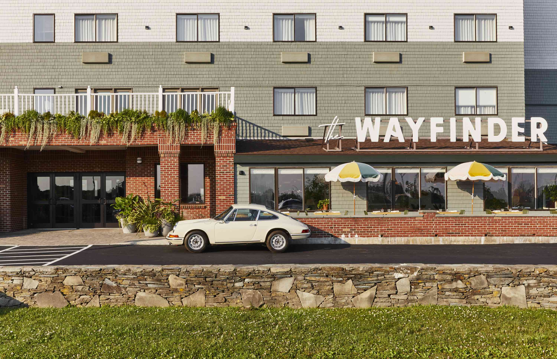 Entrance of The Wayfinder hotel with vintage Porsche in front