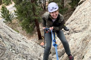 Author rappelling down a rock face