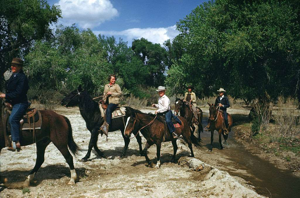 Guest ride horses on the Tanque Verde Ranch, a dude ranch in Tucson, Arizona.