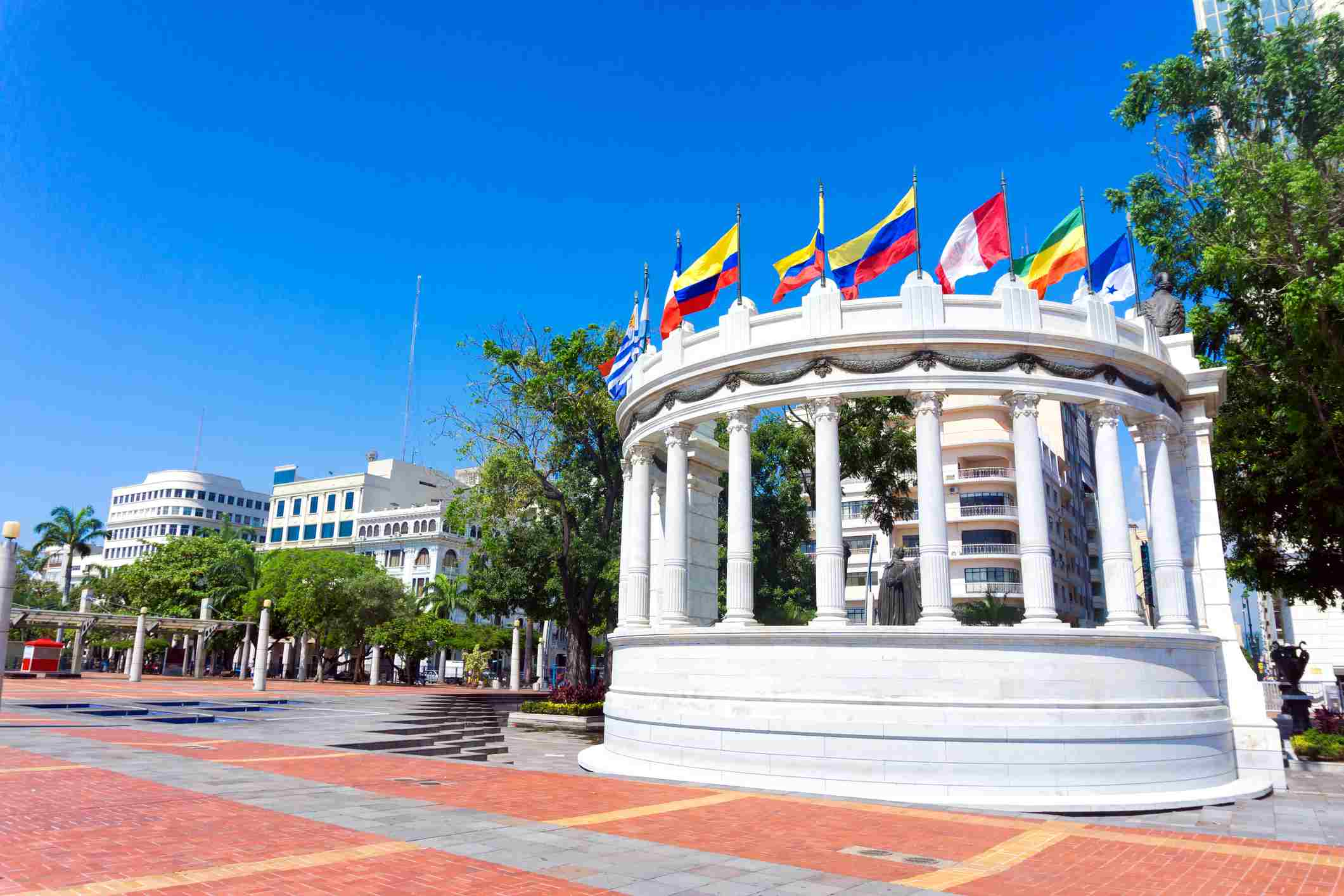 National Flags On Hemicycle De La Rotonda Malecon 2000 During Sunny Day