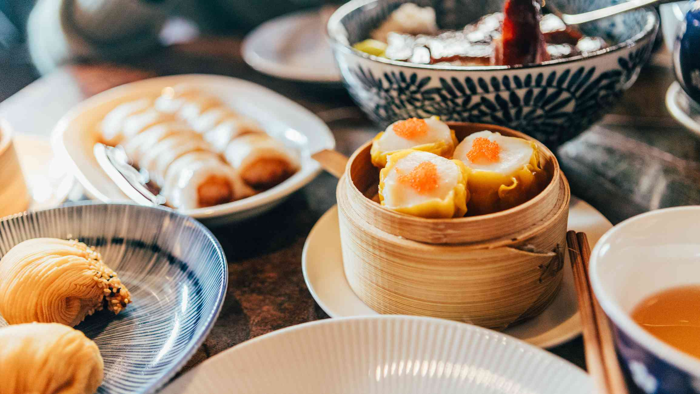 Chinese dim sum time, various traditional dim sum freshly served on table