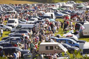 Typical busy car boot sale in summer time in UK