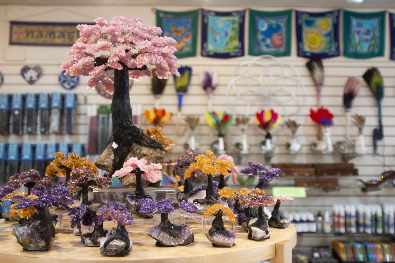 Display table with crystals of various sizes shaped like colorful flowering trees