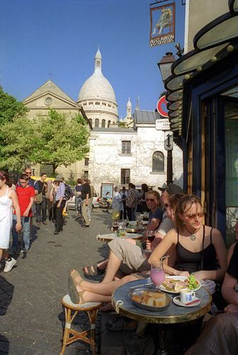 Sipping coffee and nibbling tasty food in the shadow of Sacré-Coeur Basilica