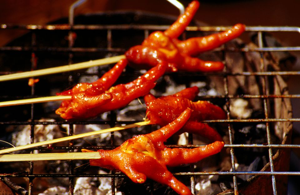 Fried chicken feet on barbecue.