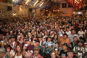 WurstFest crowd raising beer glasses