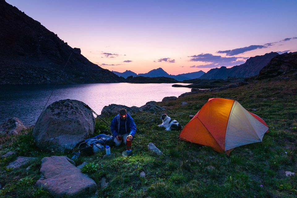 People camping by lake