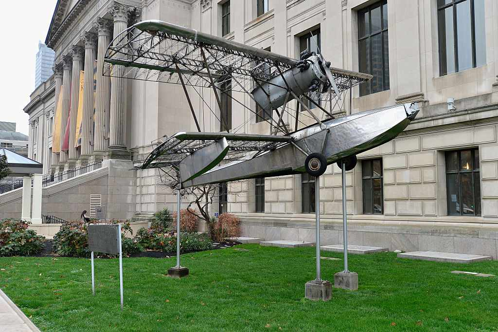 Exterior of Franklin Institute featuring a sculpture of model airplane