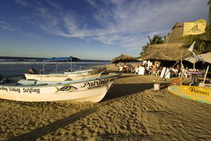 Pangas at rest on the beach at Sayulita in the golden hour before sunset, Riviera Nayarit, Mexico