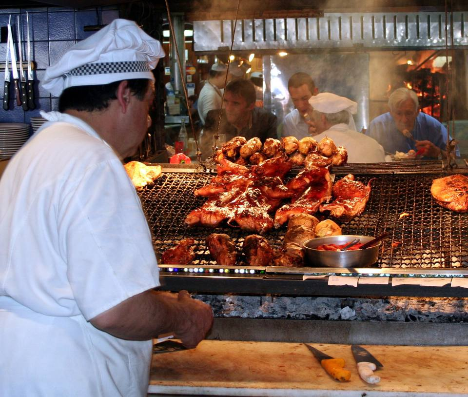 An active parrillada with working cook