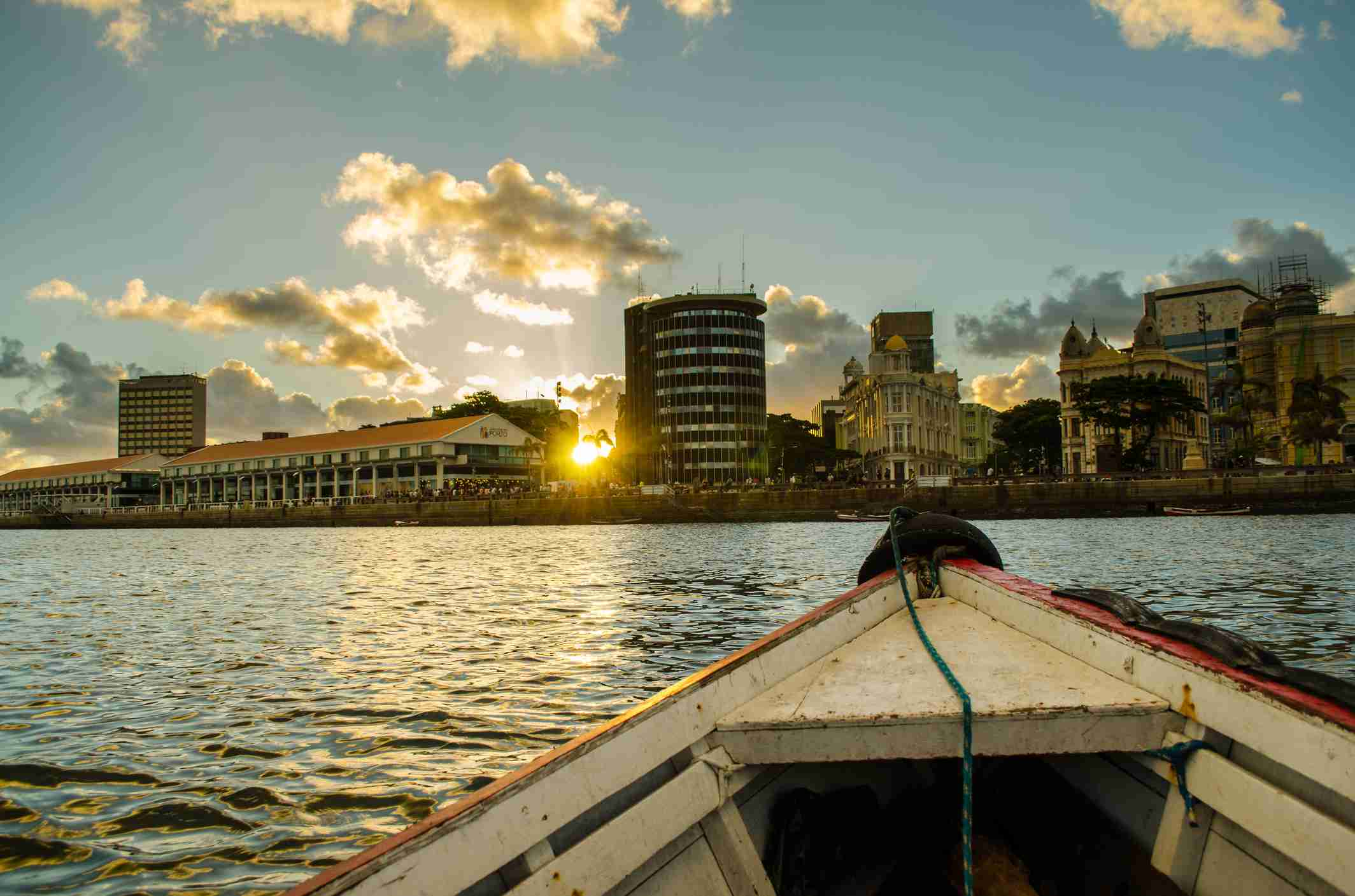 On the river channels of Downtown Recife with view towards Marco Zero during sunset