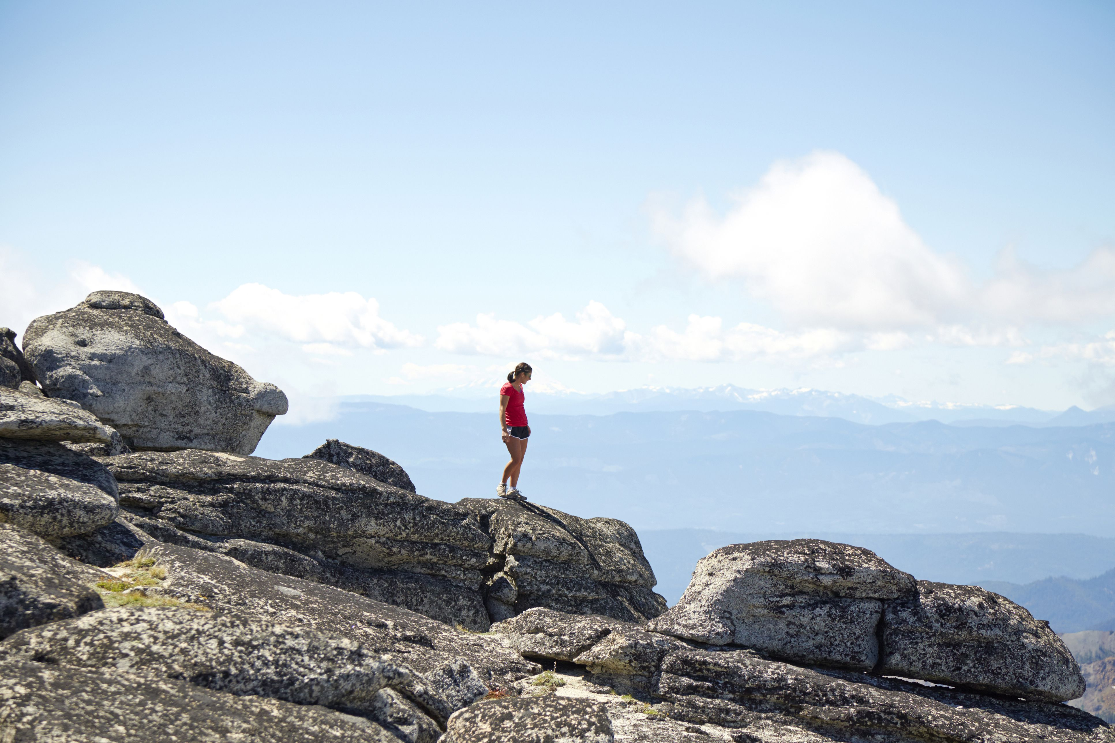 Hiker standing on hilltop in remote landscape