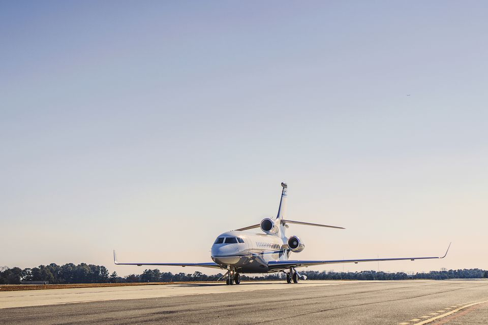 Private Jet on runway against clear sky