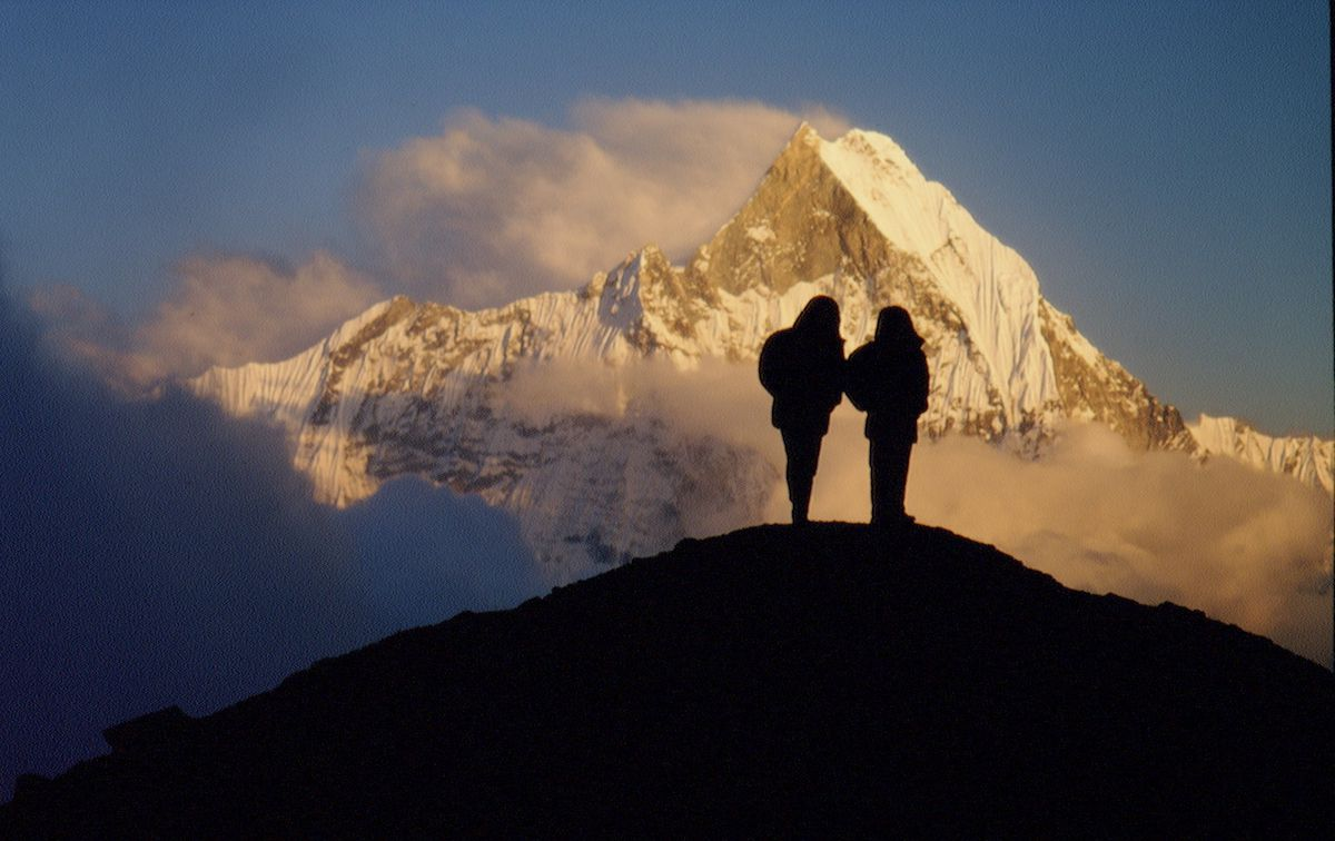 Silhouetted trekkers on the Annapurna Circuit