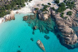 Sailboat on emerald sea in Sardinia
