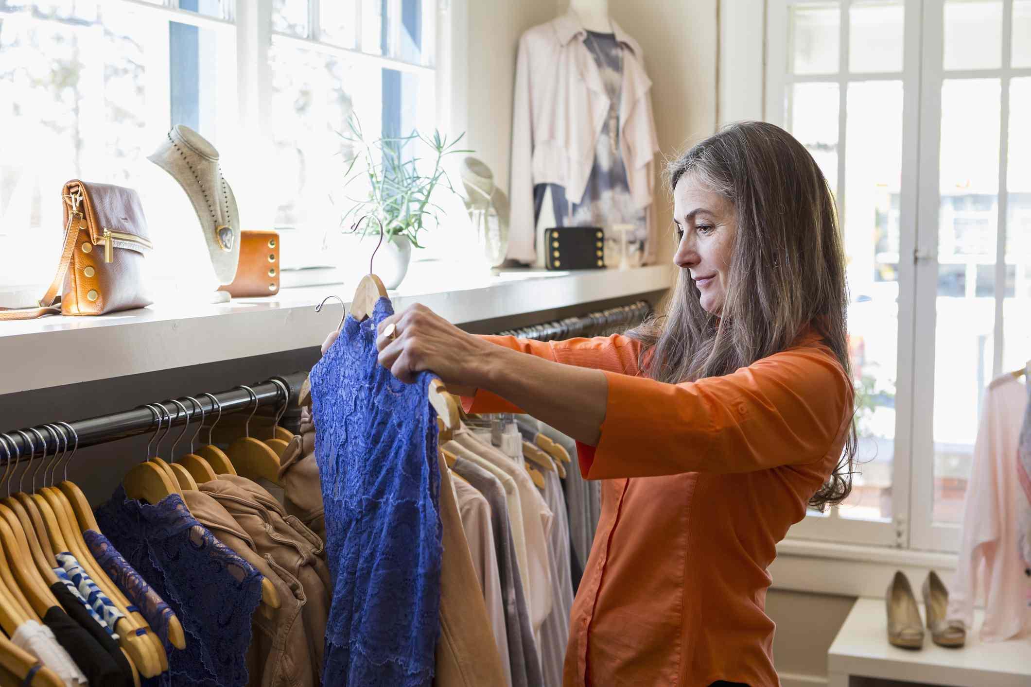 Caucasian woman shopping in clothing store