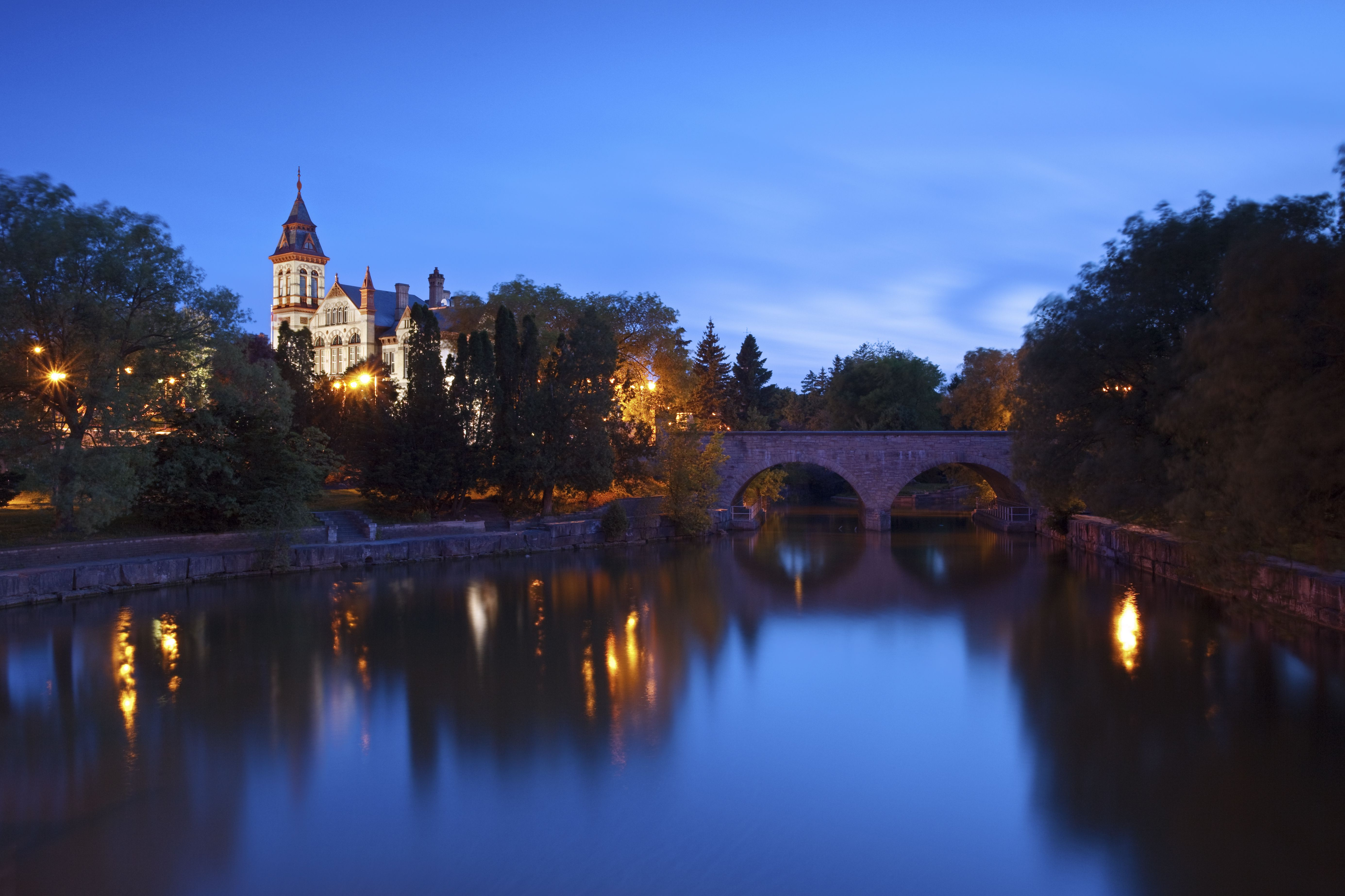 A night view of the Stratford courthouse in Stratford Ontario with the Avon river in the foreground