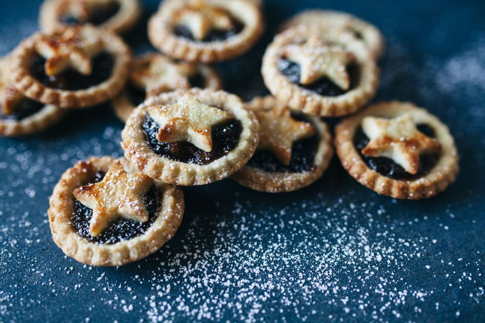 Stack of homemade mince pies with star pastry decoration