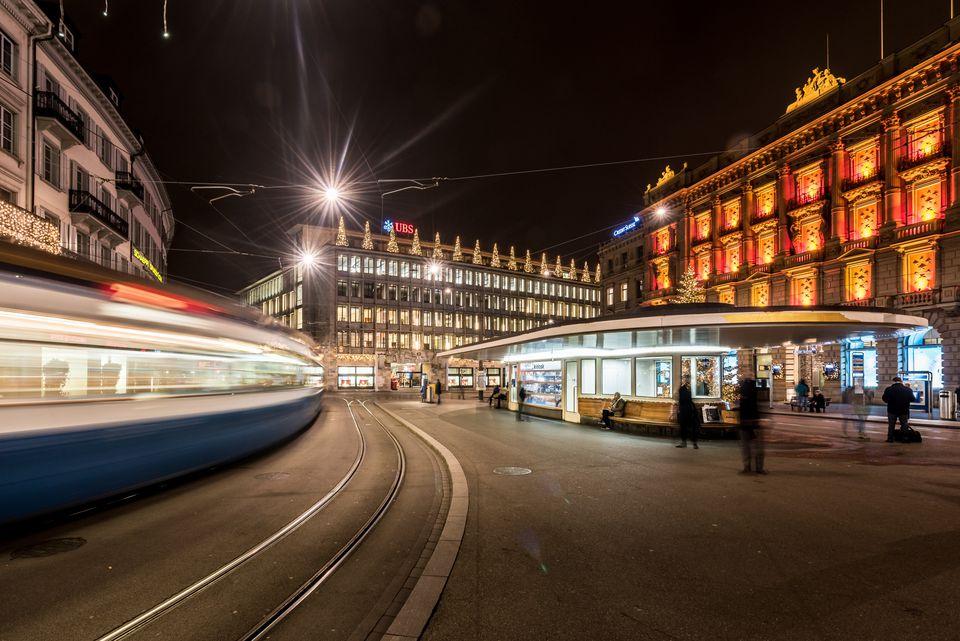 A tram passes through Paradeplatz in Zurich