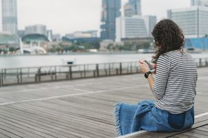 Tourist using the internet on her phone in Singapore