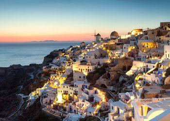 Panoramic of village of Oia at sunset, Santorini, Greece