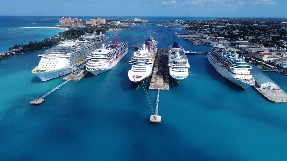 High Angle View Of Cruise Ships Moored In Sea Against Blue Sky