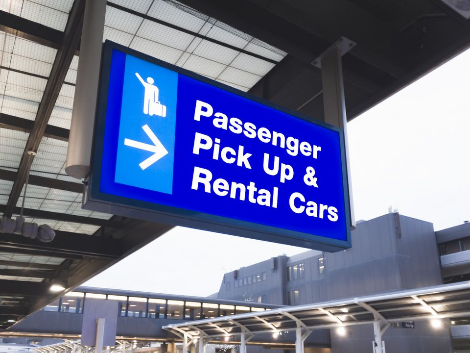 Airport sign designating passenger pick up and rental cars
