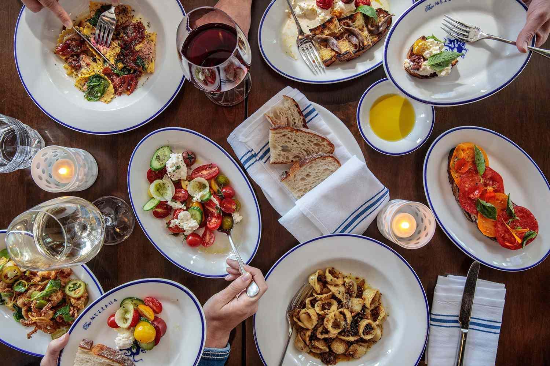 Plates of food at Bar Mezzana in Boston