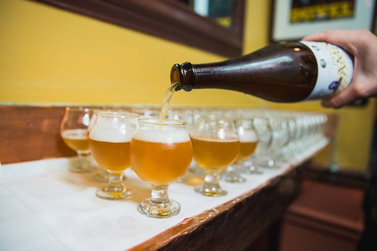 pouring beers at Monk's Cafe in Philadelphia