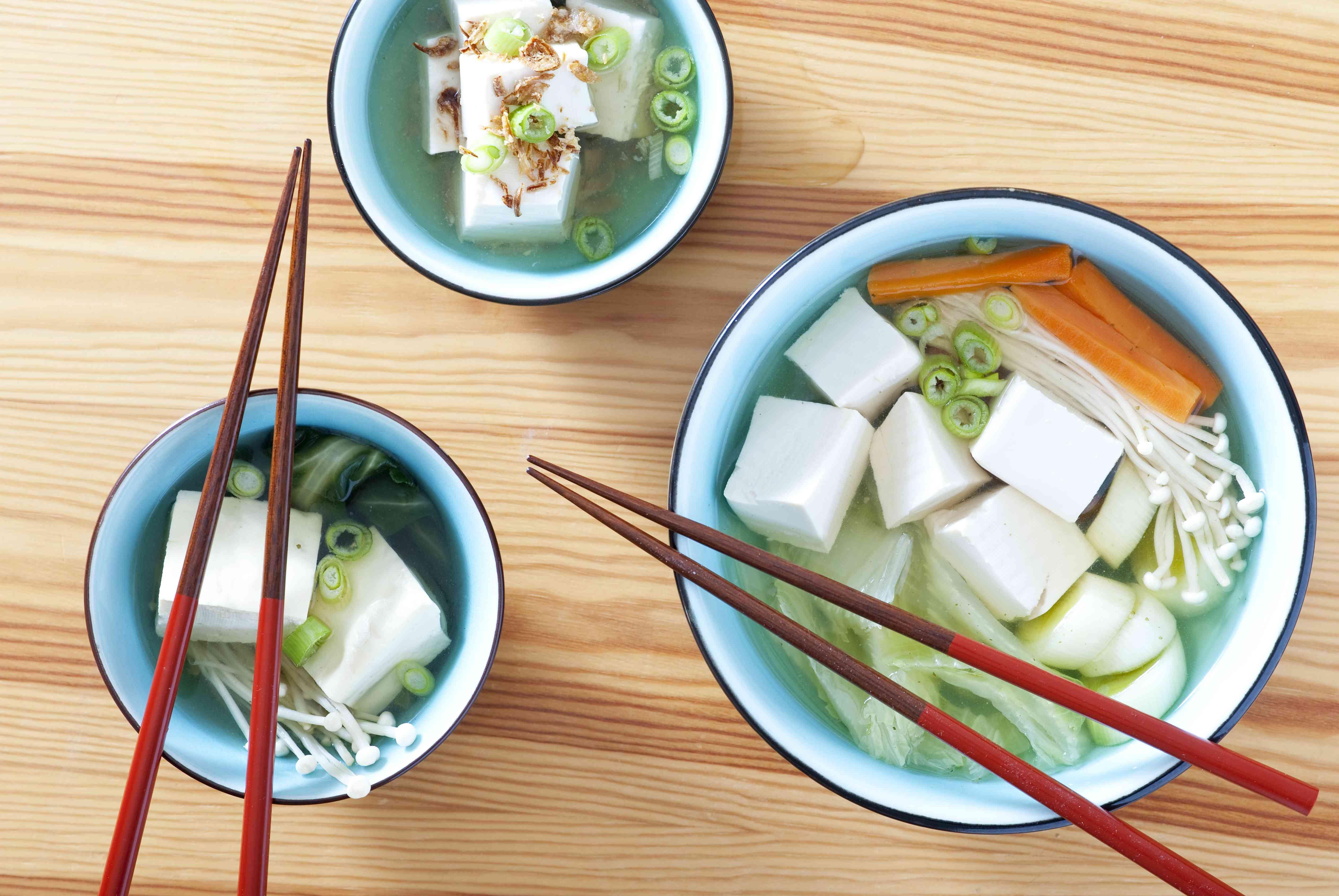 Japanese yudofu stews made of tofu and vegetables (napa cabbage, onions, carrots and mushrooms)