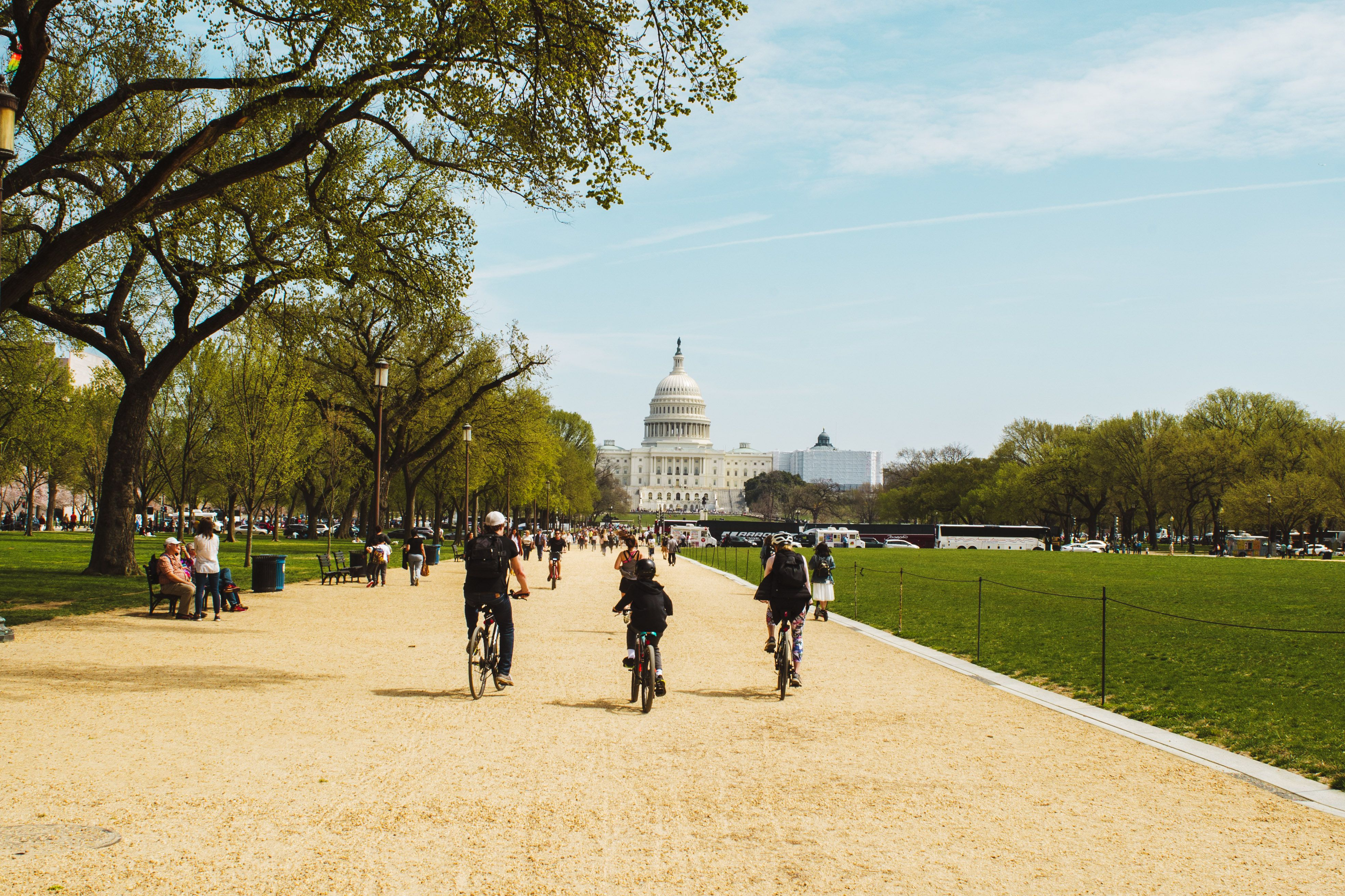 People biking towards the US Capitol building