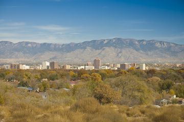 Wide view of the Albequerque skyline and the surrounding area framed by mountains