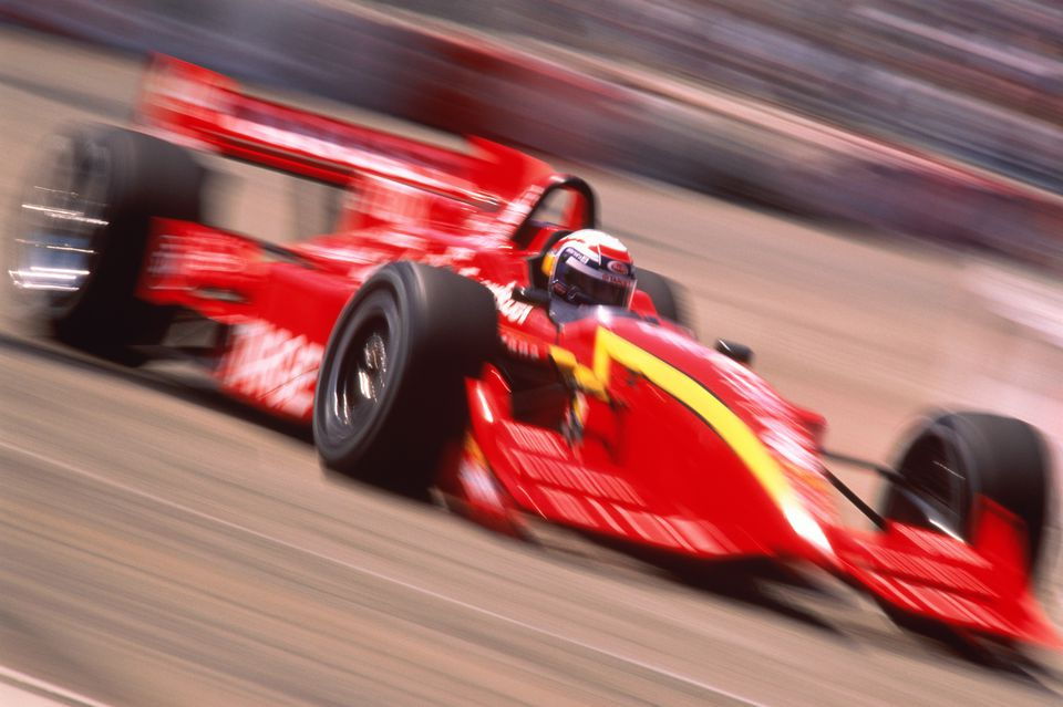 USA, IndyCar racing car on track (blurred motion)