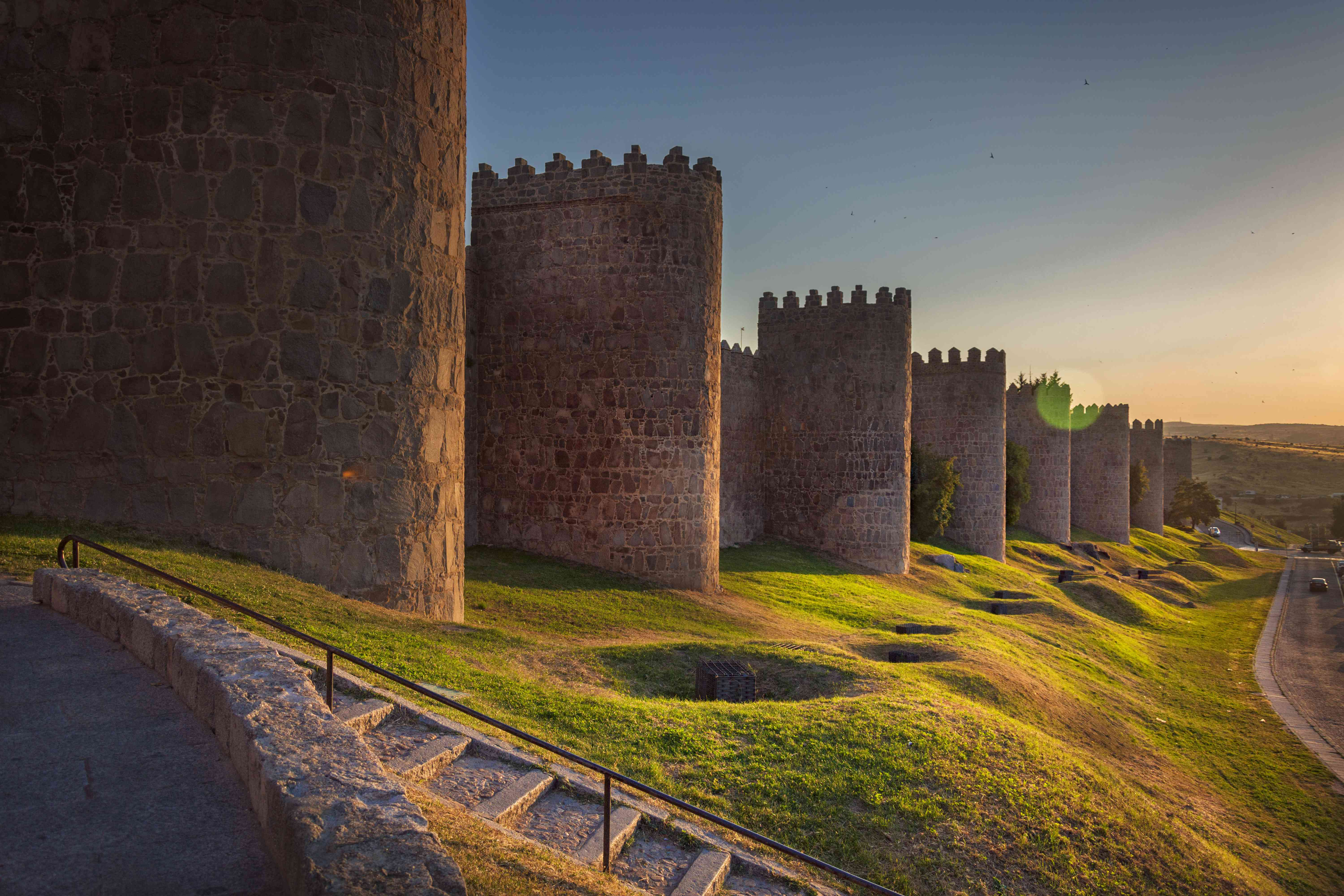 Walls of Avila at sunset. Fortified building. Fence surrounding the city