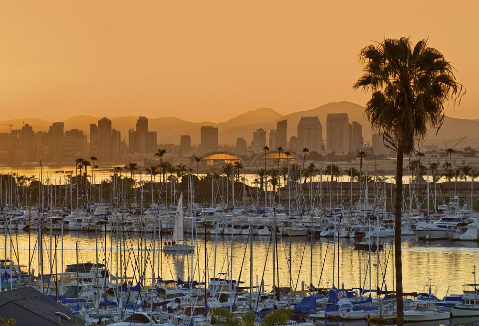 Yachts across San Diego Bay at sunrise, looking towards downtown.