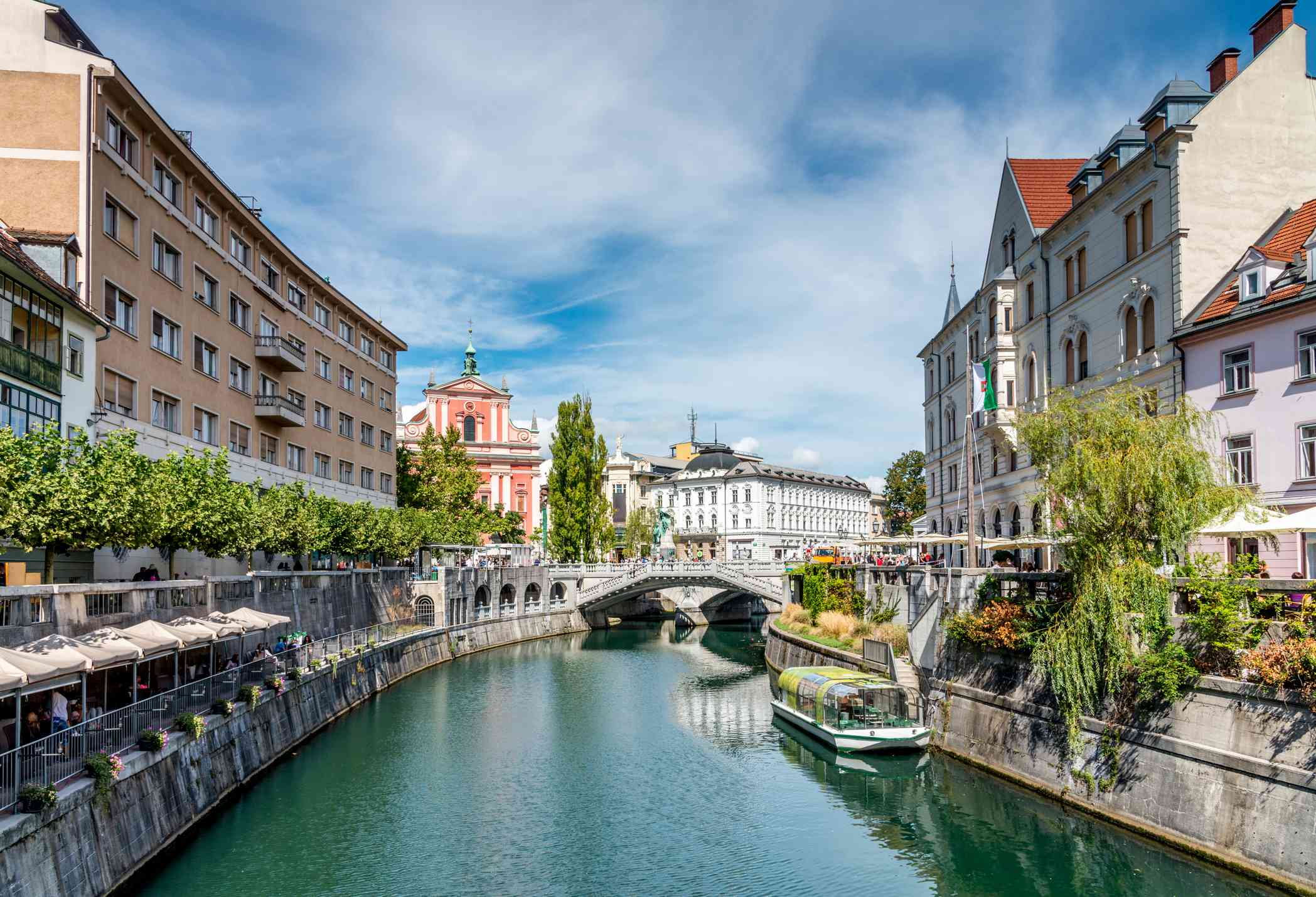 Beautiful crowded downtown Ljubljana City with Bars and Restaurants along the Ljubljanica River