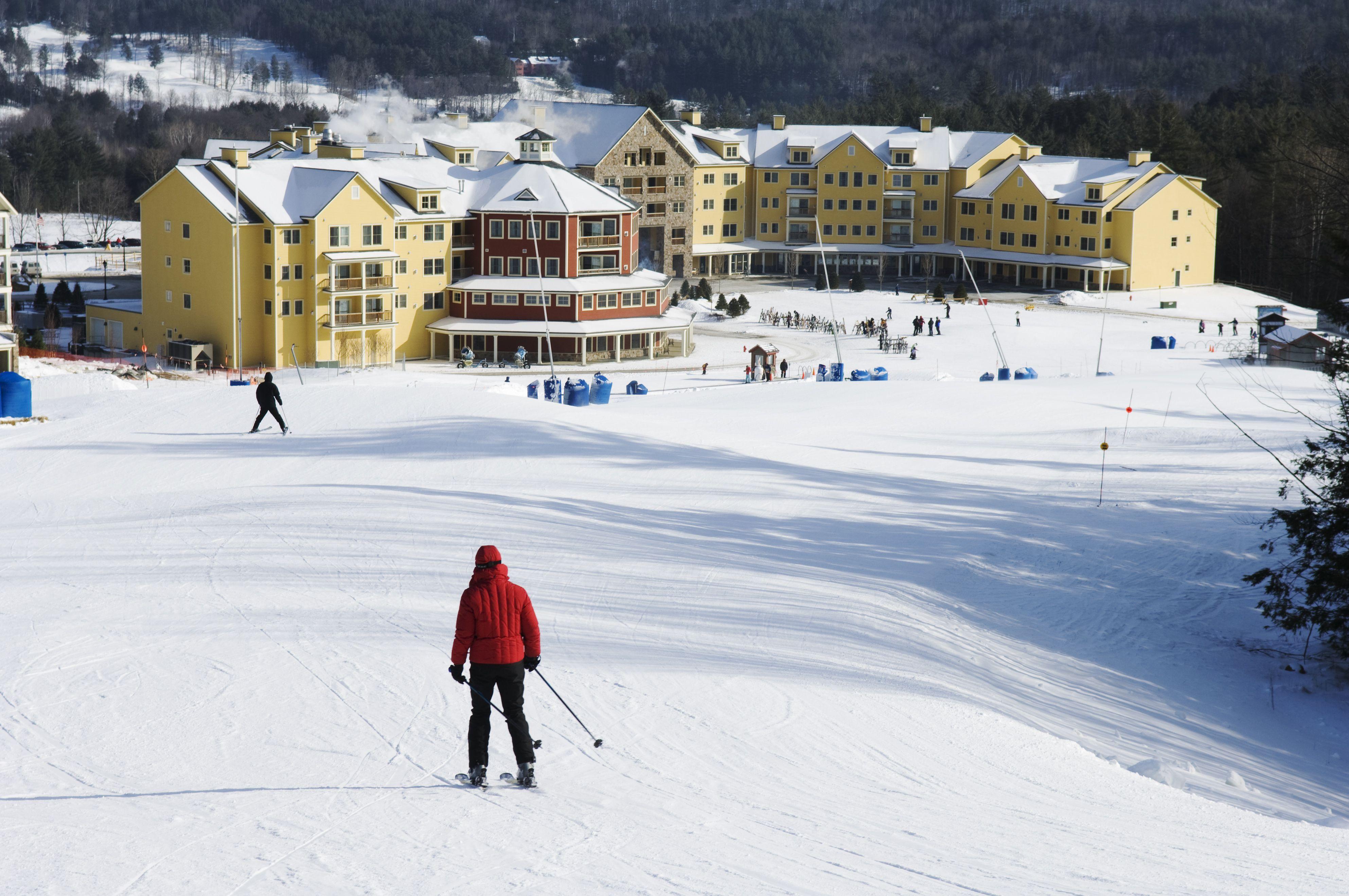 Skier heading back to the Okemo Ski resort, Okemo Valley