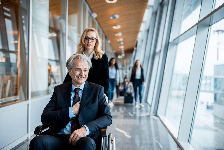 Business couple boarding a plane