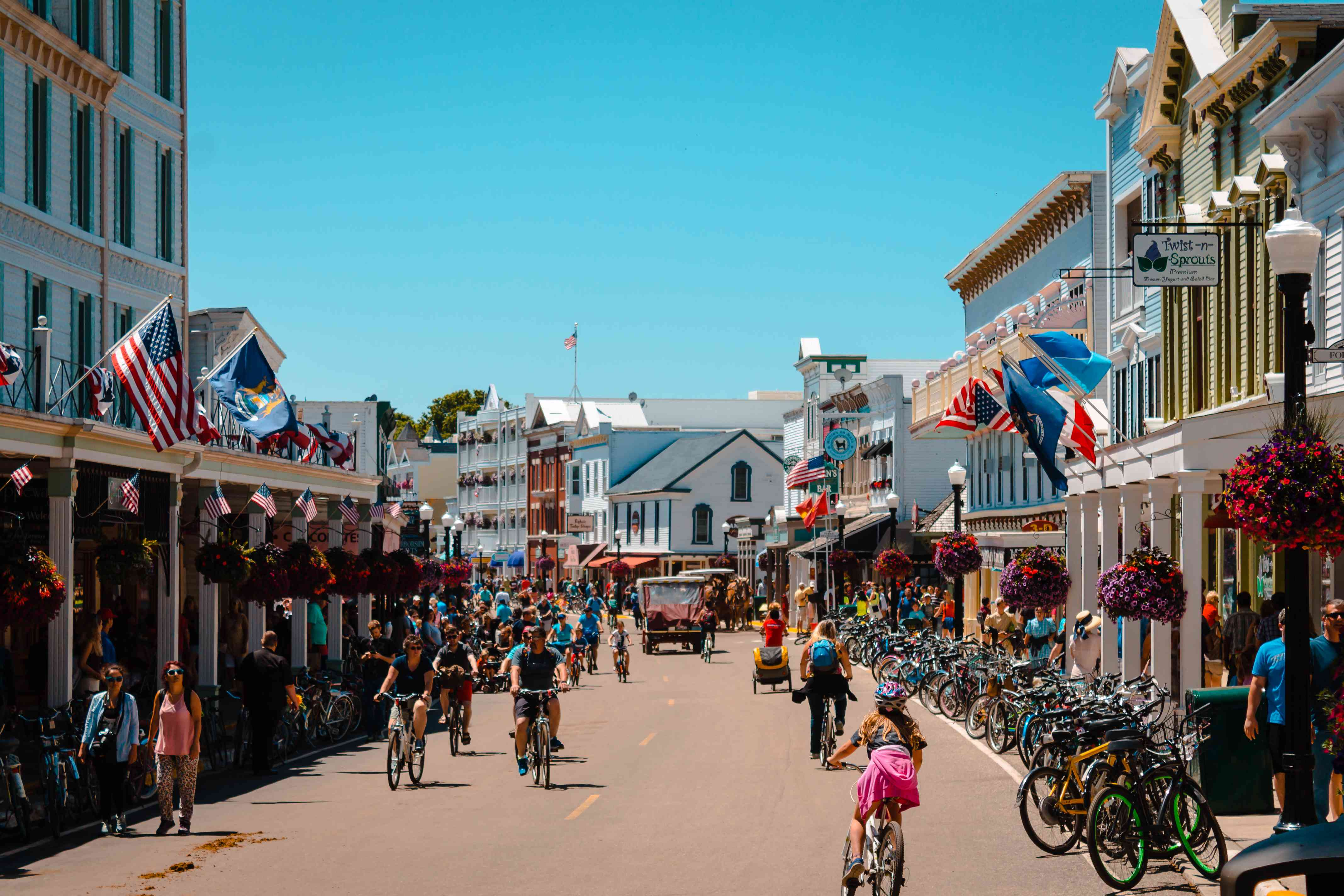 Downtown Mackinac Island street with a bunch of people riding bikes
