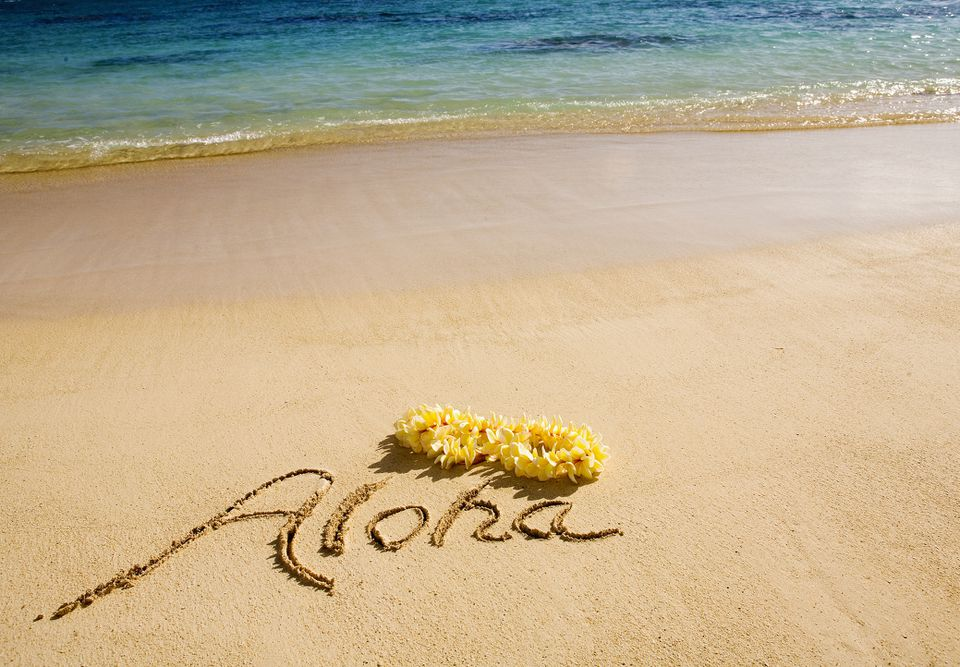 Hawaii, Oahu, Lanikai Beach, Aloha Written In The Sand With Yellow Plumeria Lei, Turquoise Ocean