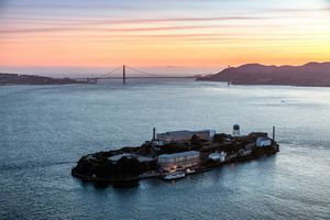 Aerial view of Alcatraz Island and the Golden Gate Bridge at sunset
