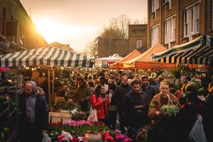 People shopping at the Columbia Road Flower Market, London (UK).