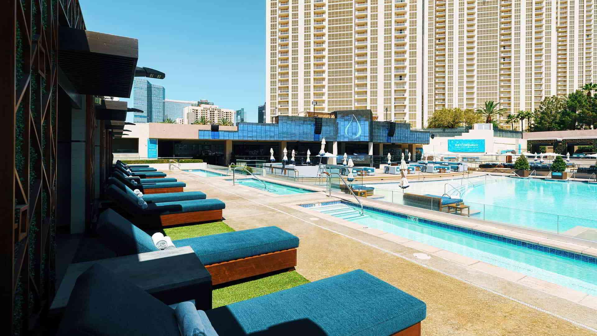 dark teal pool chairs nexts to a large pool in MGM Grand resort Las Vegas