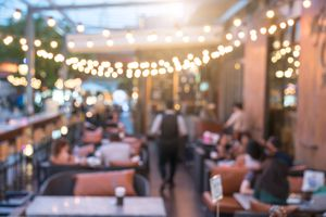 People sit in a blur outside patio dining