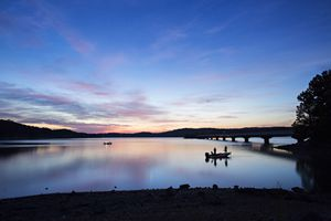Silhouette of fisherman on Beaver Lake in Northwest Arkansas