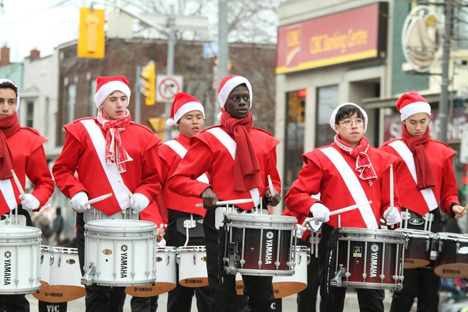 Drummers in holiday costume marching in the Etobicoke Lakeshore Santa Claus Parade