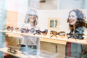 Woman Shopping for Glasses - stock photo